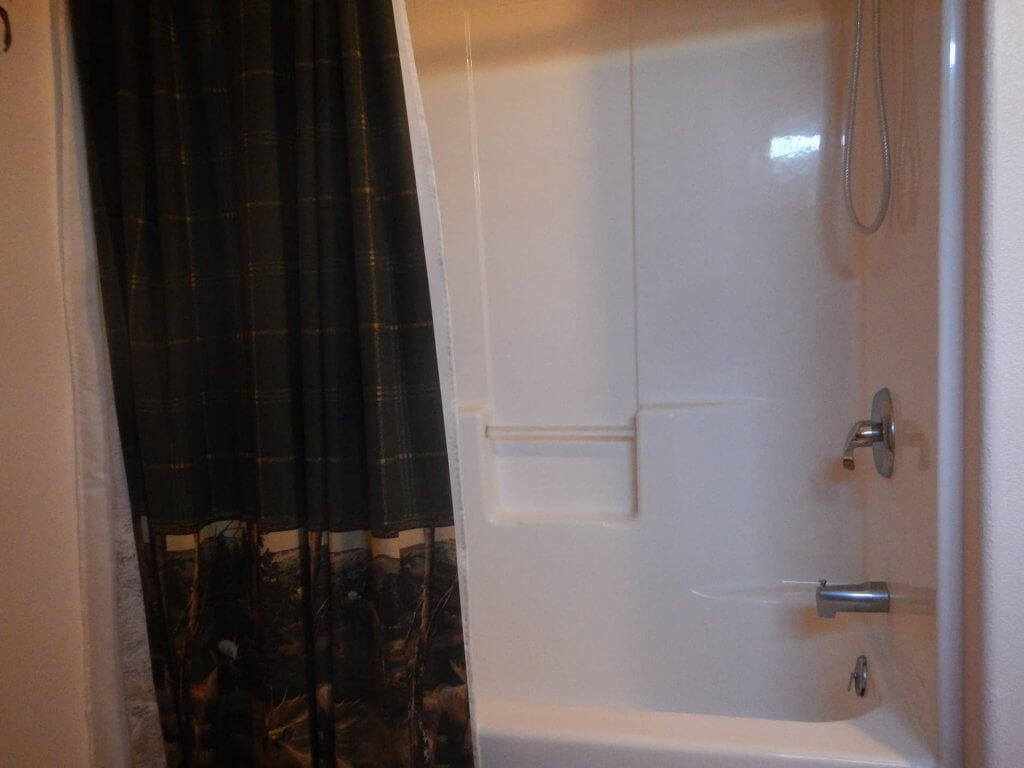 Shower/bath in Wolf Den bathroom