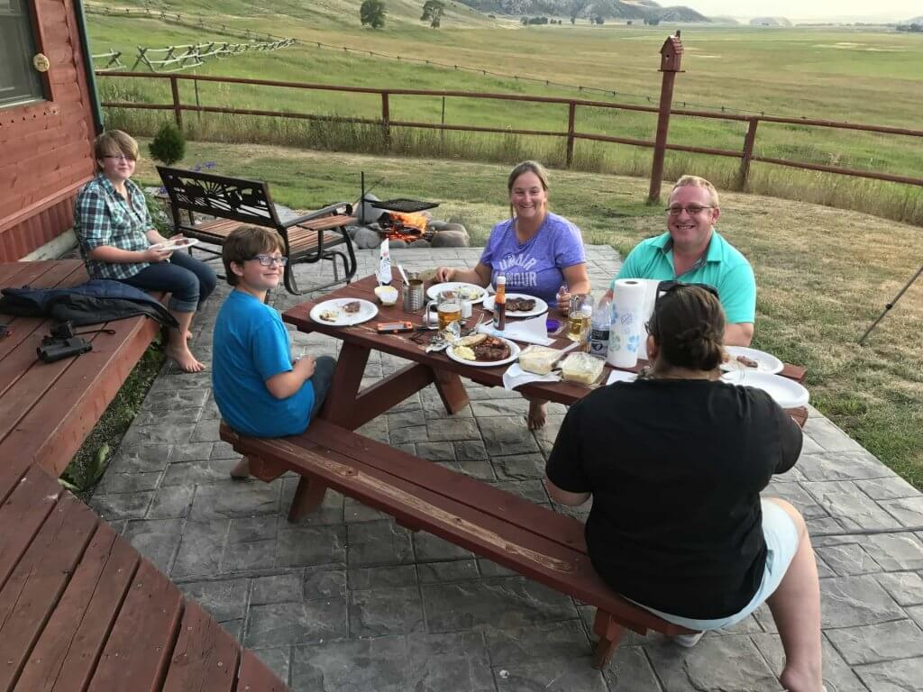 Erv and his wonderful family enjoying a steak fry over the camp fire on a beautiful Wyoming evening, and guess what, no mosquitoes here!