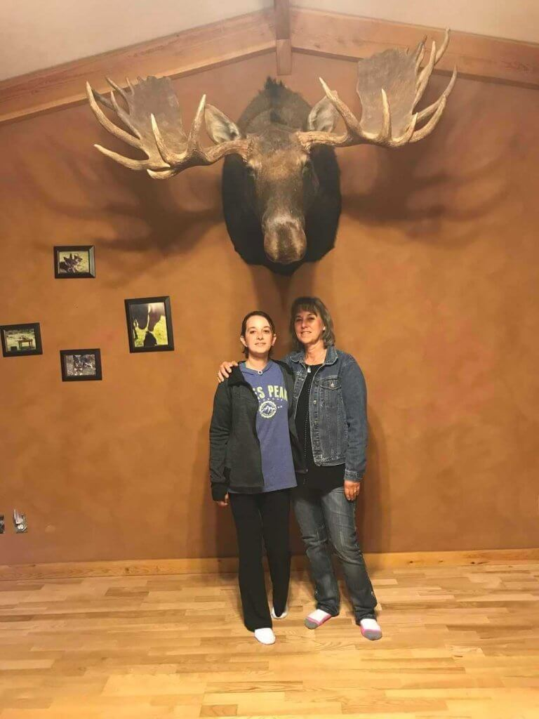 Mother and daughter posing with Bullwinkle